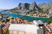 Binoculars and town Omis in Croatia — Stock Photo