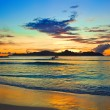 Tropical island at sunset — Stock Photo