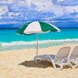 Chairs and umbrella at tropical beach — Stock Photo #7840183