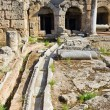 Viaduct and ruins in Corinth, Greece - Stock Photo