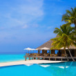 Cafe and pool on a tropical beach — Stock Photo #7952819