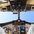 Stock Photo: Pilots in plane cockpit and sky