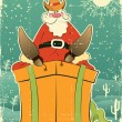 Santa Claus with cowboy hat and boots on present box.Retro card — Stock Vector #7278216