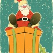 Santa Claus on rpesent box.Retro card for selebrate — 图库矢量图片