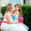 Bride with bridesmaid — Stock Photo