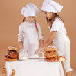 Little cute bakers — Foto de stock #6781568
