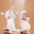 Little cute bakers - Stock Photo