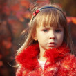Child in autumn — Foto de stock #6781664