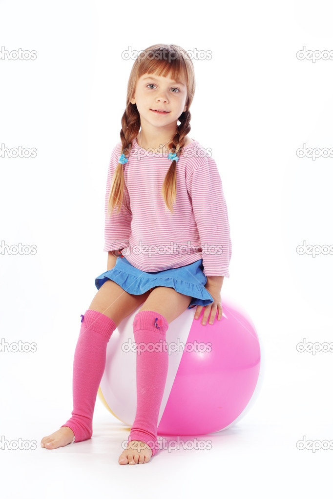 Child with colorful ball on white studio background  Stock Photo #6781459