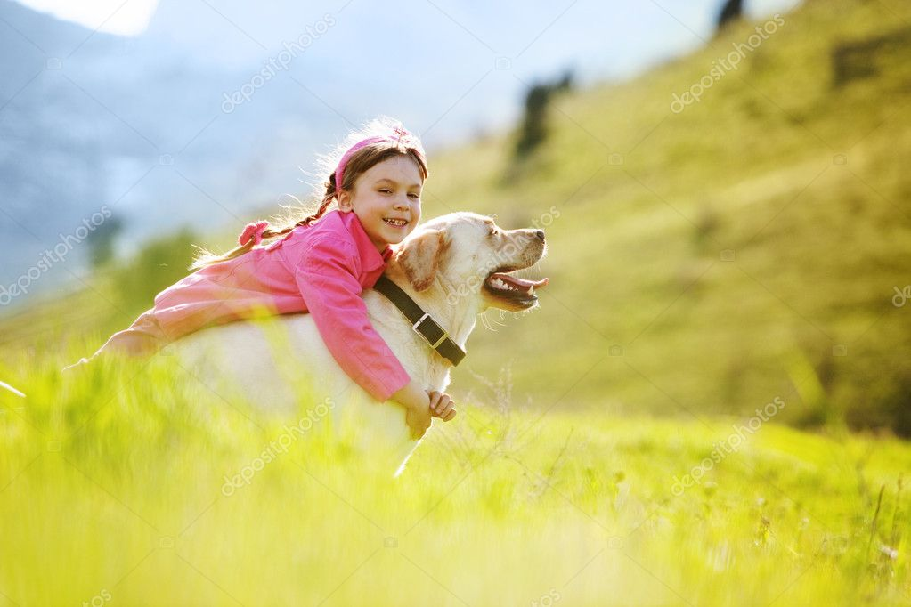 Happy child playing with dog in green field  Foto Stock #6802825