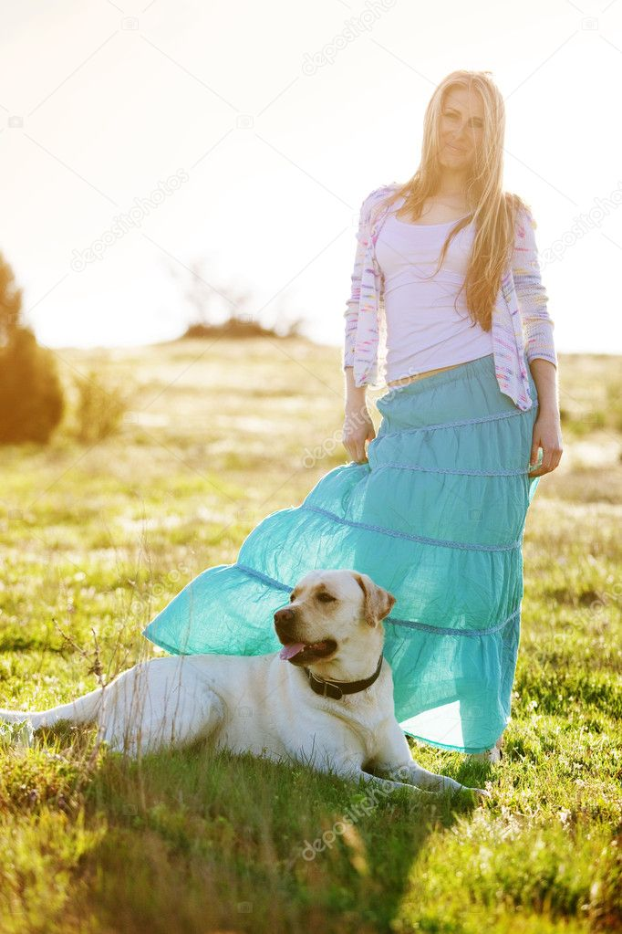 Young woman with ger dog resting at green field — Stock Photo #6802847