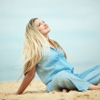 Woman resting at the beach — Stock Photo