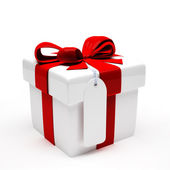 Gift with red ribbon on white background — Stock Photo