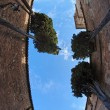 Sky above the courtyard of Medieval castle upward view - Stock Photo