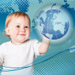 Little boy is looking at planet Earth — Stock Photo