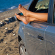 Woman's legs dangling out car window — Stock Photo #7244769