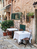 Street cafe in old town Rovinj — Stock fotografie