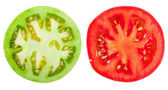 Green and red tomato slices — Stock Photo