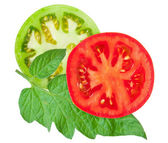 Tomato sliced with green leaf — Stock Photo