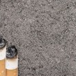 Stockfoto: Butts against tobacco ash