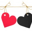 Red and black paper hearts on rope — Stock Photo
