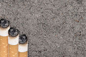 Butts against the tobacco ash — Stock Photo