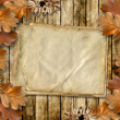 Autumn frame of oak leaves on a grange wooden background. — Stock Photo #7529733