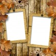 Autumn frame of oak leaves on a grange wooden background. — Stock Photo #7529784