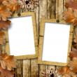 Autumn frame of oak leaves on a grange wooden background. - Stock Photo
