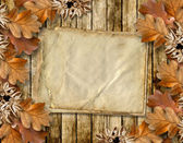 Autumn frame of oak leaves on a grange wooden background. — Photo