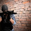Soldier in black mask targeting with a gun — Foto de Stock
