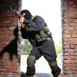 Stock Photo: Soldier in black mask targeting with a gun