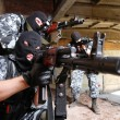 Soldiers in masks aiming the target with guns — Stock Photo #6854418
