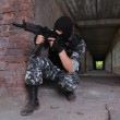 Soldier in black mask targeting with a gun — Stock Photo