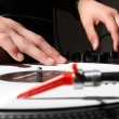 Hands of a DJ playing music from vinyl — Stock Photo