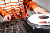 Hands of DJ scratching vinyl record — Stock Photo