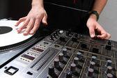 Hands of DJ scratching vinyl record — Stock Photo