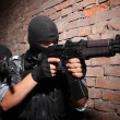 Terrorists in black masks with guns - Stock Photo