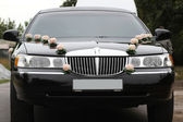Decorated wedding limousine from the front — Stock Photo