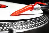 Turntable playing viyl record with music — Stock Photo