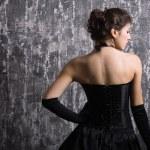 Beautiful fashionable woman in black dress. — Stock Photo #7502581