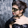 Young girl in a mysterious mask — Stock Photo