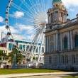 Belfast City Hall and Ferris wheel - Stock Photo