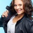 Stock Photo: Girl in leather jacket
