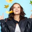 Young woman and leaf fall — Stock Photo
