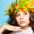 Stock Photo: Girl in autumn garland