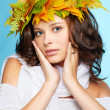 Girl in autumn garland — Stock Photo