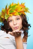 Girl in autumn garland — Stock Photo
