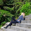 Girl on the stone steps — Stock Photo #7479235