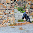 Girl on the stone steps — Stock Photo